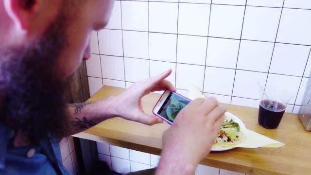 man taking food selfie - taco stock videos & royalty-free footage