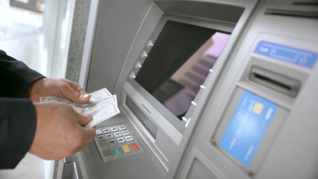 ld man taking his bank card and money from the atm - banconota video stock e b–roll