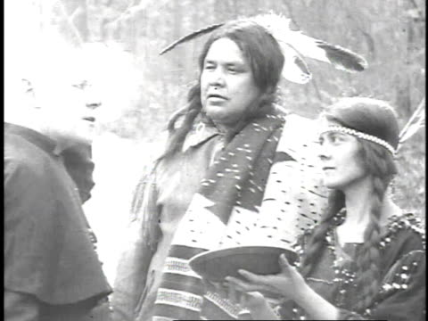 1923 reenactment man taking off hat to show his balding hair to indian who nods his head and motions to the indian woman's long hair in braids - 1923 stock videos & royalty-free footage