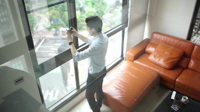 man taking panoramic photos from the apartment - males stock videos & royalty-free footage