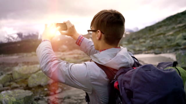 Man taking photo of nature on smartphone