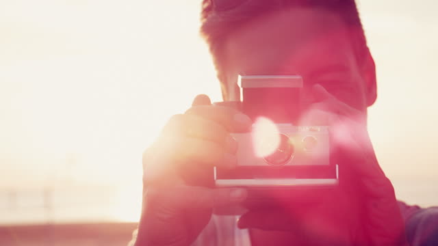 man taking photo - polaroid stock videos & royalty-free footage