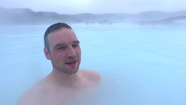 Man taking selfie in Blue Lagoon near Reykjavik, Iceland
