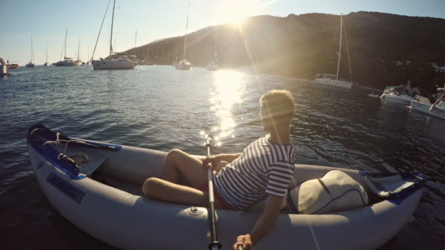 pov man taking selfie in inflatable canoe - anchored stock videos & royalty-free footage