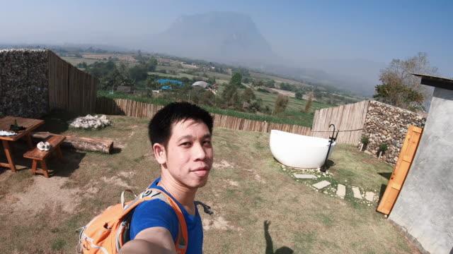 man taking selfie while travelling during the honeymoon period - honeymoon stock videos & royalty-free footage