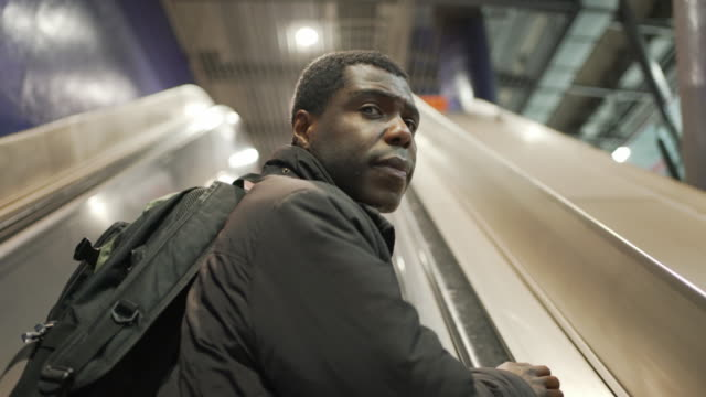 a man taking the escalator - person in further education stock videos & royalty-free footage