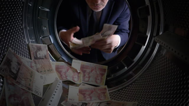 pov man taking uk pounds out of a washing machine - greed stock videos and b-roll footage