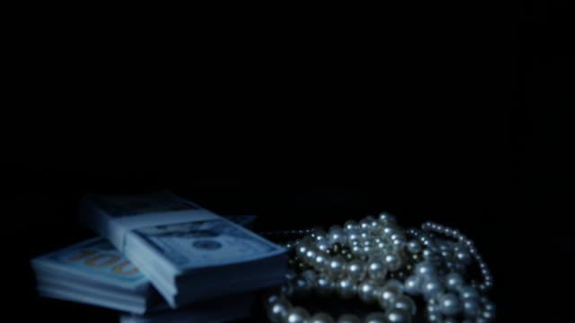 stockvideo's en b-roll-footage met pov man nemen van amerikaanse dollars en sieraden uit een kluis - parel juwelen