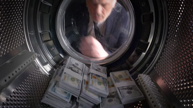 pov man taking us dollars out of a washing machine - deception stock videos and b-roll footage