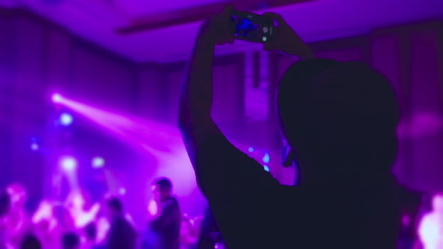 man taking video on smart phone in party - concert stock videos & royalty-free footage