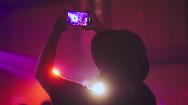 man taking video on smart phone in party - performing arts event stock videos & royalty-free footage
