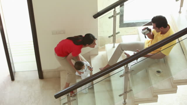 man taking videos of his daughter  - baby girls stock videos & royalty-free footage