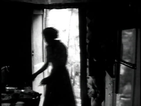 vídeos de stock, filmes e b-roll de 1962 ws man talking about mountain music as woman works in kitchen / hazard, kentucky, united states - appalachia