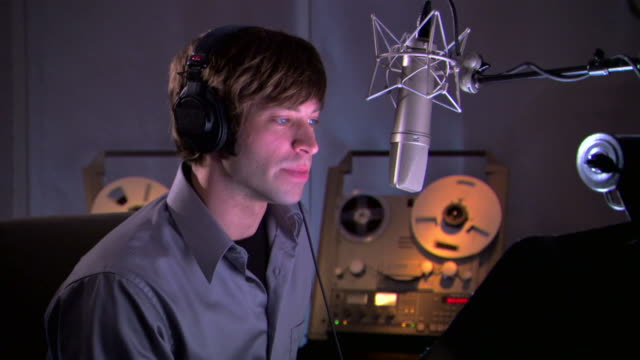 man talking into microphone in recording studio - see other clips from this shoot 1429 stock videos & royalty-free footage