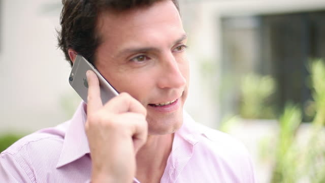 man talking on cell phone and smiling - only mature men stock videos & royalty-free footage