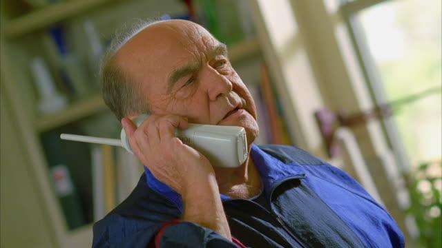 cu pan man talking on cordless phone / canyon lake, texas, usa - cordless phone stock videos & royalty-free footage