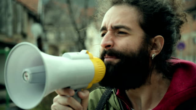 man talking on megaphone - displeased stock videos and b-roll footage