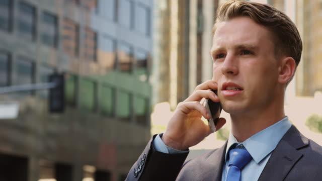 Man Talking on Telephone in Street