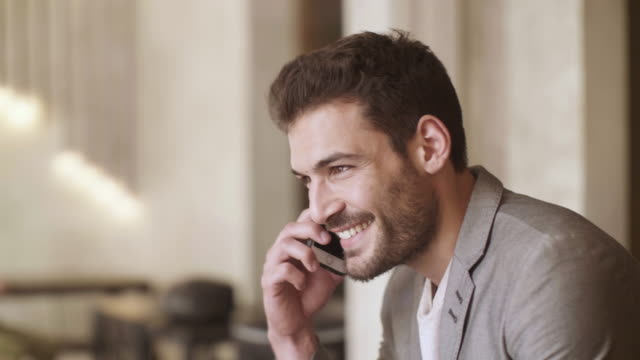 man talking on the phone - handsome people stock videos & royalty-free footage