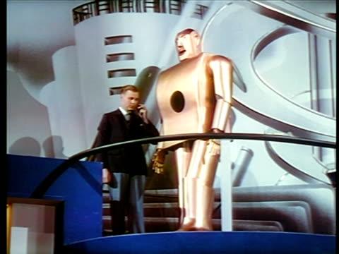 man talking to robot + turning it / new york world's fair / industrial - new york world's fair stock videos & royalty-free footage