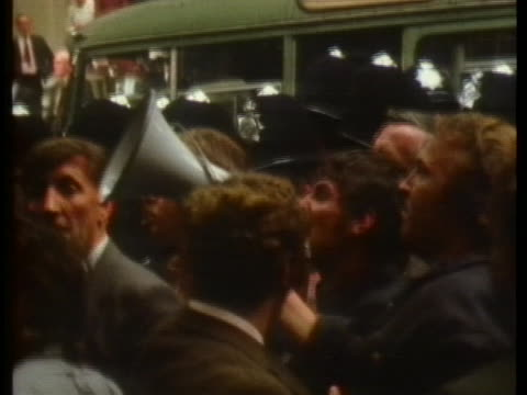 man talks on a bullhorn in a crowd during the strike of longshoremen in london, england. - megaphone stock videos & royalty-free footage
