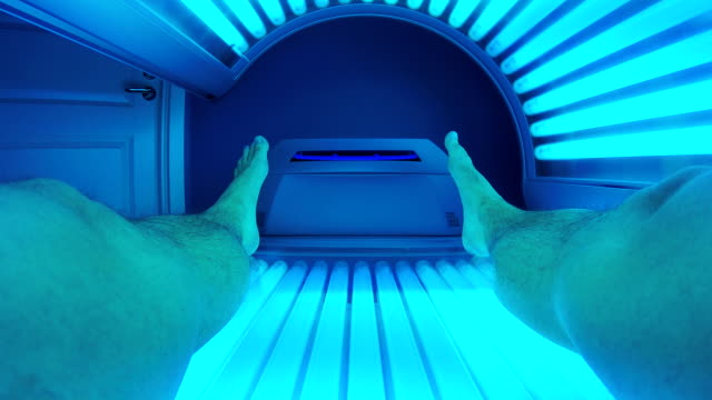 man tanning in solarium - sunbathing stock videos and b-roll footage