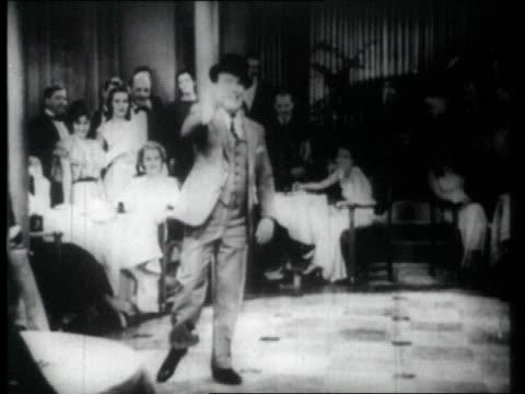 1926 ms man tap dancing in front of audience, falls - 1926 bildbanksvideor och videomaterial från bakom kulisserna
