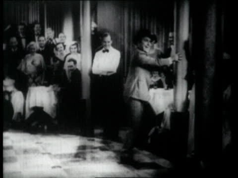 1926 ms man tap dancing in front of audience, falls - dance floor stock videos and b-roll footage