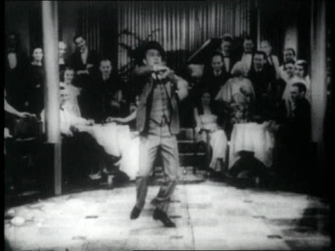 1926 montage man tap dancing in front of audience, falls - tap dancing stock videos & royalty-free footage