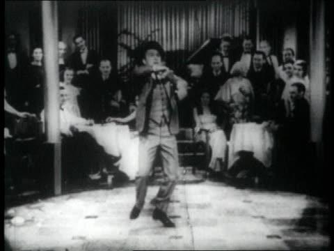 1926 montage man tap dancing in front of audience, falls - 1926 bildbanksvideor och videomaterial från bakom kulisserna