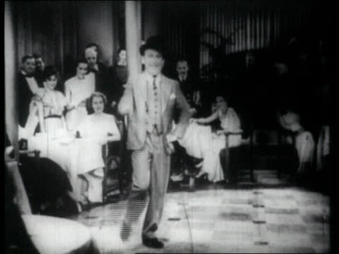 vídeos de stock, filmes e b-roll de 1926 ms man tap dancing in front of audience - tapping