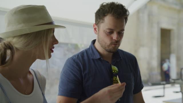 man tasting gelato with woman at urban shop / cordoba, cordoba, spain - tasting stock videos & royalty-free footage
