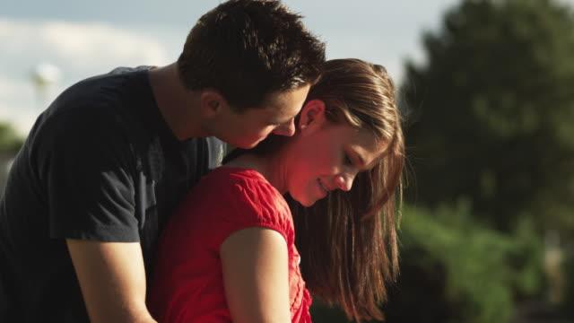 cu tu man teaching woman swinging golf club, woman turning and kissing man / orem, utah, usa - orem utah stock videos & royalty-free footage