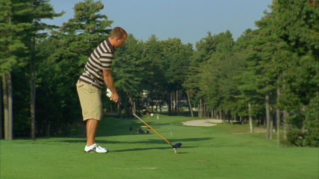 ms, man teeing off on golf course, saco, maine, usa - teeing off stock videos & royalty-free footage