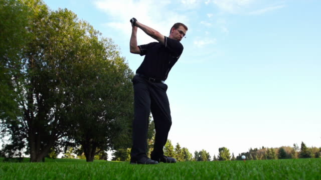 man tees off - golfer stock videos and b-roll footage
