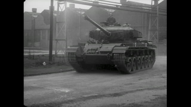 man test drives tank; 1956 - british military stock videos & royalty-free footage