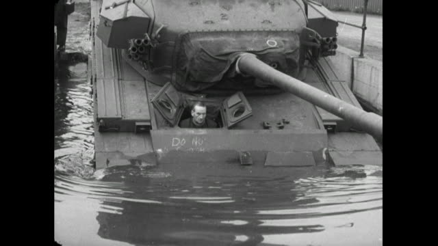 man test drives tank into water; 1956 - british military stock videos & royalty-free footage