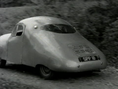 a man test drives the new atom car by reversing it along a country lane - 試運転点の映像素材/bロール