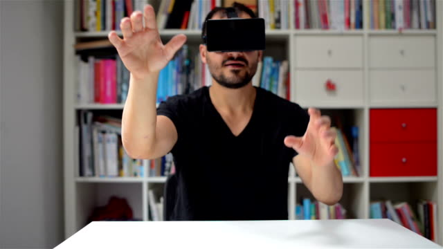 DOLLY SHOT: Man testing VR glasses