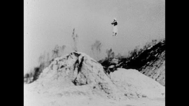 man tests a prototype rocket-propelled jetpack; 1966 - 宇宙服点の映像素材/bロール