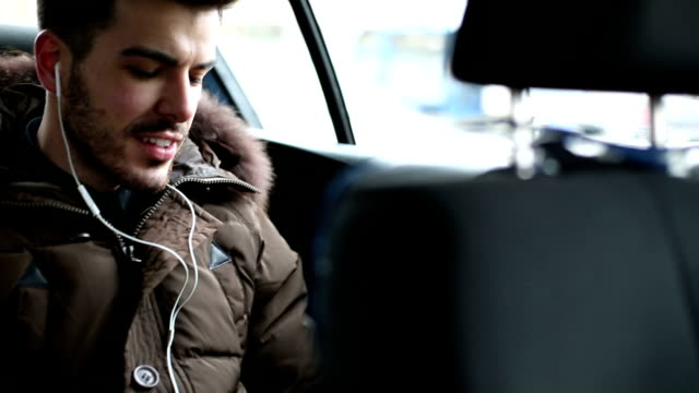 Man text messaging in the car
