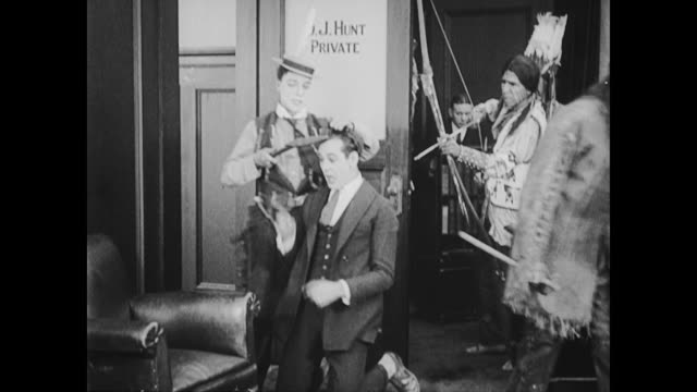 1922 Man (Buster Keaton) threatens escaping businessmen with scalping