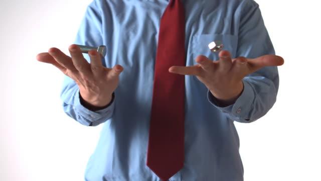 vídeos y material grabado en eventos de stock de man throwing a bolt and a screw in each hand - camisa y corbata