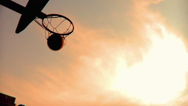 SLO MO LA MS Man throwing basketball into hoop, Jacksonville, Florida, USA
