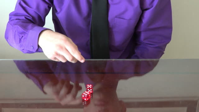 a man throwing dice over a table - shirt and tie stock videos & royalty-free footage