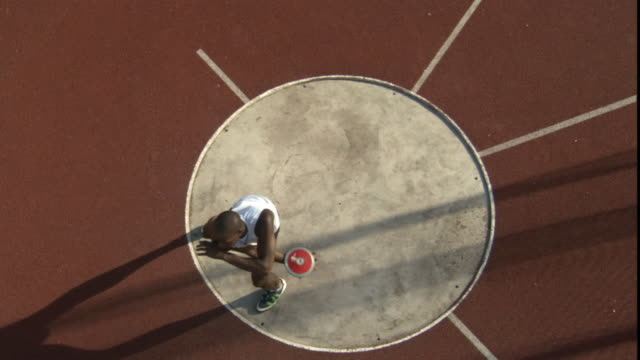 oh ws man throwing discus/ sheffield, england - spinning stock videos & royalty-free footage