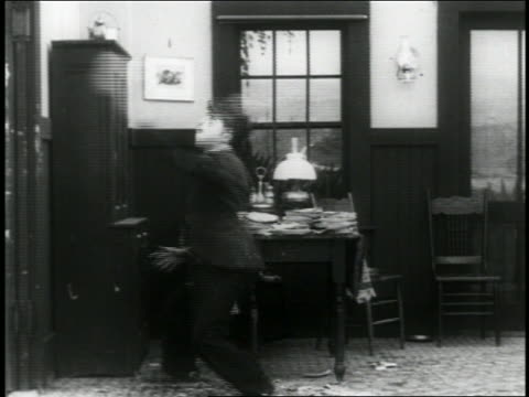b/w 1916 man throwing pie / hits fat man in face / short - 1916 stock videos & royalty-free footage