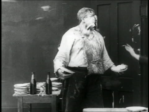 b/w 1916 man throwing pie / it hits big man / / short - 1916 stock videos & royalty-free footage