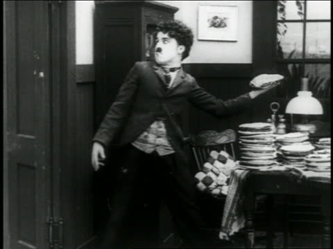 b/w 1916 man throwing pie / short - 1916 stock videos & royalty-free footage