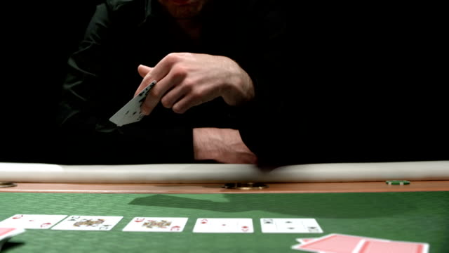 hd: man throwing poker cards at camera - deception stock videos and b-roll footage
